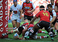 JOHANNESBURG, South Africa, 02 April 2011. Digby Ioane of the Reds dots down for his try with Joshua Strauss of the Lions too late to stop him during the Super15 Rugby match between the Lions and the Reds at Coca-Cola Park in Johannesburg, South Africa on 02 April 2011. .Photographer : Anton de Villiers / SPORTZPICS