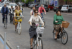April 29, 2017 - Kiev, Ukraine - Participants with their bikes attend ''Retro Cruise'' or ''Tweed run'', a retro parade on bicycles, in Kiev, Ukraine, on 29 April 2017. (Credit Image: © Serg Glovny via ZUMA Wire)