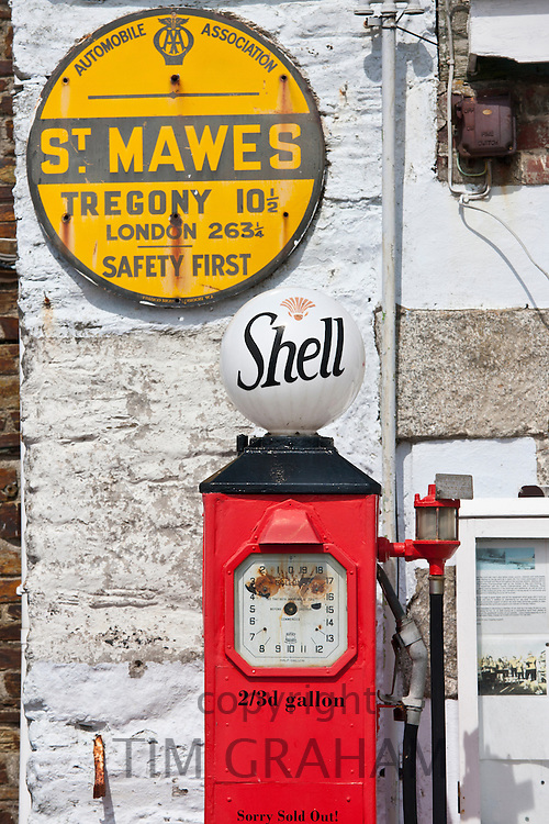 Vintage Shell petrol pump and Automobile Association AA sign ephemera at St Mawes tourist attraction, Cornwall, England, UK