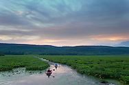 Mamakating, New York - People paddle out into the Bashakill Wildlife Management Area during a moonlight canoe and kayak trip sponsored by the Basha Kill Area Association on the evening of July 21, 2013.