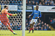 Portsmouth Midfielder, Jamal Lowe (10) closes down Rochdale Goalkeeper, Josh Lillis (1) during the EFL Sky Bet League 1 match between Portsmouth and Rochdale at Fratton Park, Portsmouth, England on 13 April 2019.