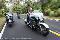 Brian Klock of Klock Werks in Mitchell, SD with Vanessa Nay ride their 2017 Jack Daniels Indian Chieftain limited edition that Brian designed for Indian beside Jake Cutler (L) on his custom Indian Chieftain during Daytona Beach Bike Week. FL. USA. Monday March 13, 2017. Photography ©2017 Michael Lichter.