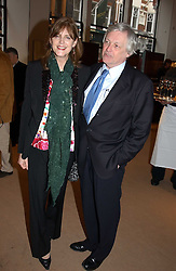 FRANK JOHNSON and his wife VIRGINIA JOHNSON mother of Lord Lovatat a party to celebrate the publication of 'Last Voyage of The Valentina' by Santa Montefiore at Asprey, 169 New Bond Street, London W1 on 12th April 2005.<br />
