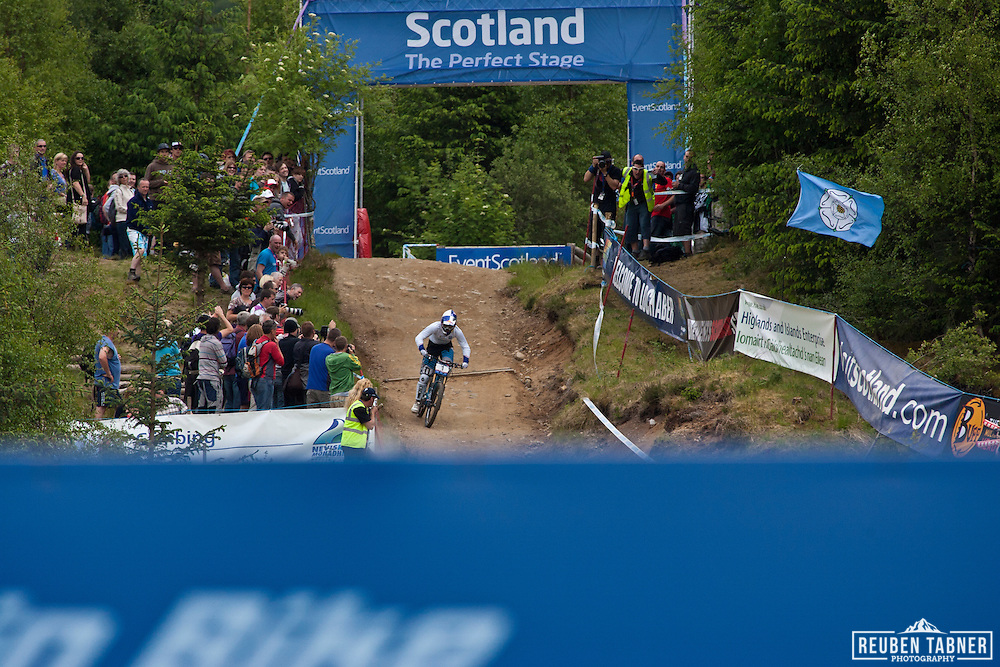 Rachel Atherton flys through the Scotland arch during the women's downhill, to take second place against Maxxis Rocky Mountain's Sabrina Jonnier. UCI Mountain Bike World Cup, Fort William, Scotland.