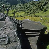 Cordillera Vilcabamba, Andes Mountains, Peru. Travelers examine sacred rock at Vitcos, last stronghold of Manco Inca.