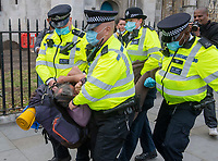 Police arrest Extinction Rebellion protester at the demonstration in Parliament Square. photo by Brian Jordan