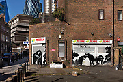 Painting of Hyenas on a closed shop by Petticoat Lane market during the coronavirus pandemic on the 2nd May 2020 in London, United Kingdom.
