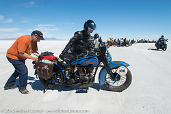 Buzz Kanter lends a hand to Pat Simmons of the Doobie Brothers with his 1929 Harley-Davidson JD after the Panorama portrait on the Bonneville Salt Flats during stage 12 (299 m) of the Motorcycle Cannonball Cross-Country Endurance Run, which on this day ran from Springville, UT to Elko, NV, USA. Wednesday, September 17, 2014.  Photography ©2014 Michael Lichter.