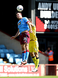 Tom Hopper of Scunthorpe United challenges Tom Lockyer of Bristol Rovers  - Mandatory by-line: Matt McNulty/JMP - 06/08/2016 - FOOTBALL - Glanford Park - Scunthorpe, England - Scunthorpe United v Bristol Rovers - Sky Bet League One
