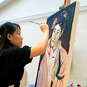 A pupil painting during an art lesson at The Mount School, York, UK. The Mount School is a Quaker independent day and boarding school in York, England, for girls aged 11–18. It was founded in 1785.