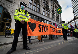 © Licensed to London News Pictures. 25/08/2021. London, UK. XR (Extinction Rebellion) protesters gather outside the Brazialian Embassy on a global day of action for Indigenous Peoples of the Amazon rainforest. XR are on day three of a planned two week protest in the captital calling for action on climate change. Photo credit: Peter Macdiarmid/LNP