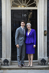 April 18, 2018 - London, UK - Prime Minister of Canada Justin Trudeau (L) and Prime Minister Theresa May (R) outside 10 Downing Street. (Credit Image: © Rob Pinney/London News Pictures via ZUMA Wire)