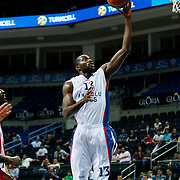 Anadolu Efes's Stephane Lasme (C) and Olympiacos's George Printezis (R) during their Gloria Cup Basketball Tournament match Anadolu Efes between Olympiacos at Ulker Sports Arena in istanbul Turkey on Tuesday 23 September 2014. Photo by Aykut AKICI/TURKPIX