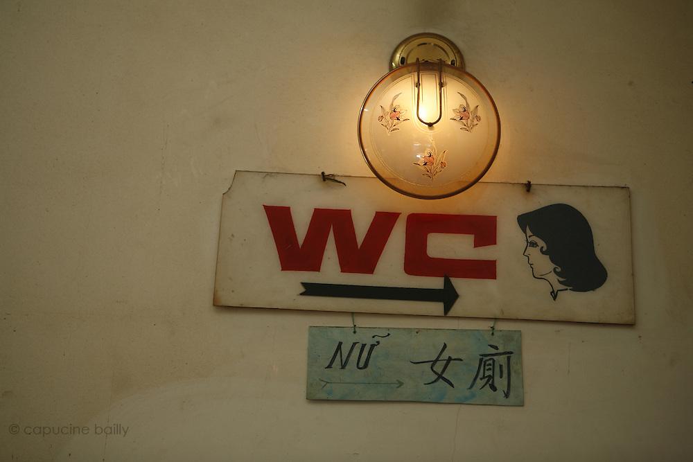 Ho Chi Minh City (Saigon), Vietnam. .March 16th 2007..The bathroom sign in the Pagoda Thien Hau.