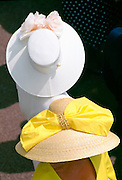 Ladies in traditional hats at Ascot races, UK
