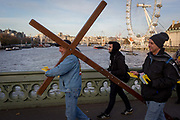 Christians hand out religious leaflets to tourists on Westminster Bridge, on 1st December 2017, in Westminster, London, England.