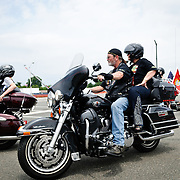 Riders heading off toward DC in the annual Rolling Thunder motorcycle rally through downtown Washington DC on May 29, 2011. This shot was taken as the riders were leaving the staging area in the Pentagon's north parking lot, where thousands of bikes and riders had gathered.