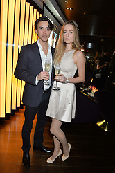 NIALL BISER and ALEXA WATERS at the Launch Of Osman Yousefzada's 'The Collective' 4th edition with special guest collaborator Poppy Delevingne held in the Rumpus Room at The Mondrian Hotel, 19 Upper Ground, London SE1 on 24th November 2014, sponsored by Storm models and Beluga vodka.