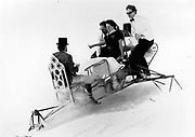 David Kirke, Tim Hunt, Nicky Slade  and Lord Xan Rufus Isaacs going down on dining table, Dangerous Sports Club ski race. St. Moritz. 1983.<br /> © Copyright Photograph by Dafydd Jones<br /> 66 Stockwell Park Rd. London SW9 0DA<br /> Tel 0171 733 0108