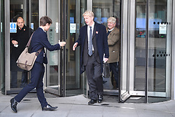 """© Licensed to London News Pictures. 10/11/2018. London, UK. JO JOHNSON MP and his father STANLEY JOHNSON are seen leaving BBC Broadcasting House in London after JO JOHNSON resigned as transport minister yesterday. Mr Johnson, brother of former foreign secretary Boris Johnson, resigned his ministerial post saying it's """"imperative we go back to the people and check"""" they still want to leave. Photo credit: Ben Cawthra/LNP"""