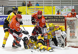 Ziga Grahut of Jesenice and Andrej Tavzelj of Jesenice vs Jonathan Ferland and Reinhard Divis of Vienna during ice-hockey match between HK Acroni Jesenice and UPC Vienna Capitals of 25th Round of EBEL League 2011/2012, on November 25, 2011 in Arena Podmezakla, Jesenice, Slovenia. Acroni Jesenice defeated Vienna Capital 3-2 after penalty shots. (Photo By Vid Ponikvar / Sportida.com)