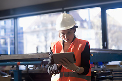 Female engineer using a digital tablet in an industrial plant, Freiburg Im Breisgau, Baden-Württemberg, Germany