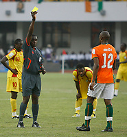 Photo: Steve Bond/Richard Lane Photography.<br /> Ivory Coast v Benin. Africa Cup of Nations. 25/01/2008. Abdouleye Meite (R) is booked by ref Marange Kenias