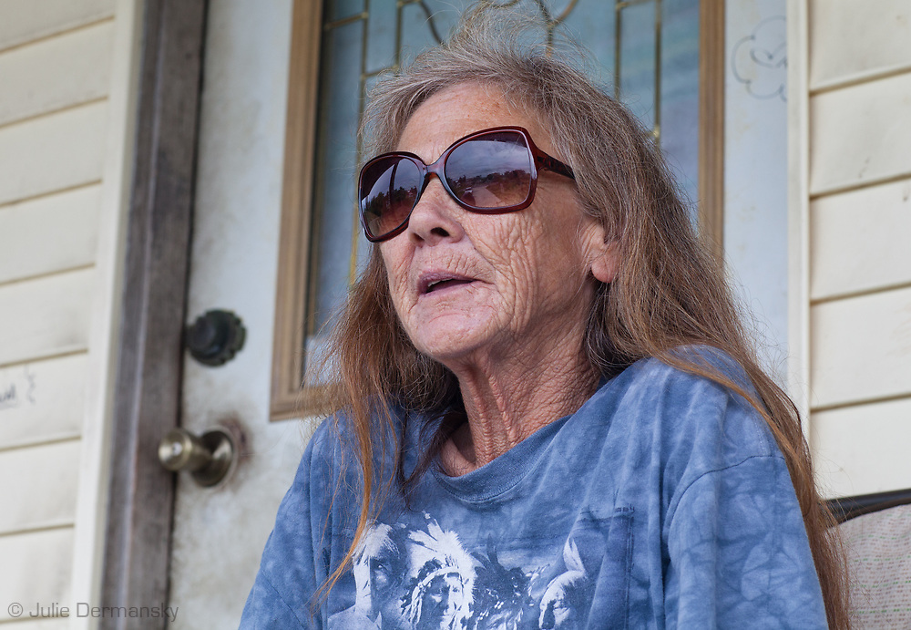 Mandy Verdin on her porch in Point-aux-Chien Louisiana is a member of the Pointe- au-Chien indian tribe. The native tribes in Terribone Parrish may soon become environmental refugees as their land erodes with the rising tides.