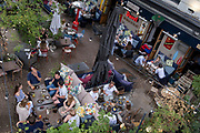 An aerial view of customers enjoying al fresco dining and drinking at a bar at London Bridge in Southwark, on 10th June 2021, in London, England. (Photo by Richard Baker / In Pictures via Getty Images)