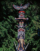 Legendary bird Quolus, Red Cedar-bark Man with Canoe, Double-headed serpent Sisiyutl and Siwidi figures on the Ga'akstalas Pole, carved by Wayne Alfred and Beau Dick in 1991 and based on a Kwakwaka'wakw design by Russell Smith.  Totem pole on display at Stanley Park, Vancouver, British Columbia, Canada.