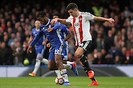 Michy Batshuayi of Chelsea (L) in action with John Egan of Brentford (R). The Emirates FA Cup 4th round match, Chelsea v Brentford at Stamford Bridge in London on Saturday 28th January 2017.<br /> pic by Steffan Bowen, Andrew Orchard sports photography.