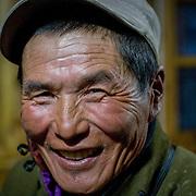 Portrait of happy middle aged Mongolian horseman (Khangil Nuur, Mongolia - Sep. 2008) (Image ID: 080915-1917241a)