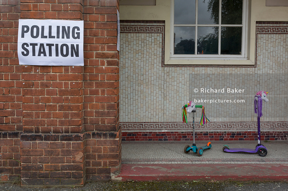Childrens' scooters left outside their local polling station on the morning of the UK 2017 general elections outside St. Saviour's Parish Hall in Herne Hill, Lambeth, on 8th June 2017, in London, England.