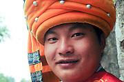 China, Yunnan province, Kunming, Man in traditional dress