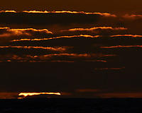Sun setting over the Pacific Ocean from the deck of the MV World Odyssey. Semester at Sea, 2016 Spring Semester Voyage. Day 2 of 102. Image taken with a Nikon 1 V3 camera and 70-300 mm VR lens (ISO 200, 300 mm, f/16, 1/125 sec).