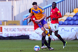 Ollie Clarke of Mansfield Town collides with Yann Songo'o of Morecambe - Mandatory by-line: Ryan Crockett/JMP - 27/02/2021 - FOOTBALL - One Call Stadium - Mansfield, England - Mansfield Town v Morecambe - Sky Bet League Two