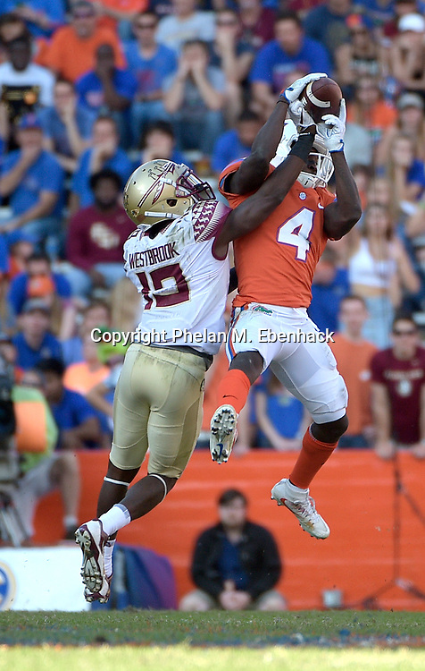 Florida State defensive back A.J. Westbrook (19) knocks away a pass intended for Florida wide receiver Brandon Powell (4) during the second half of an NCAA college football game Saturday, Nov. 25, 2017, in Gainesville, Fla. FSU won 38-22. (Photo by Phelan M. Ebenhack)