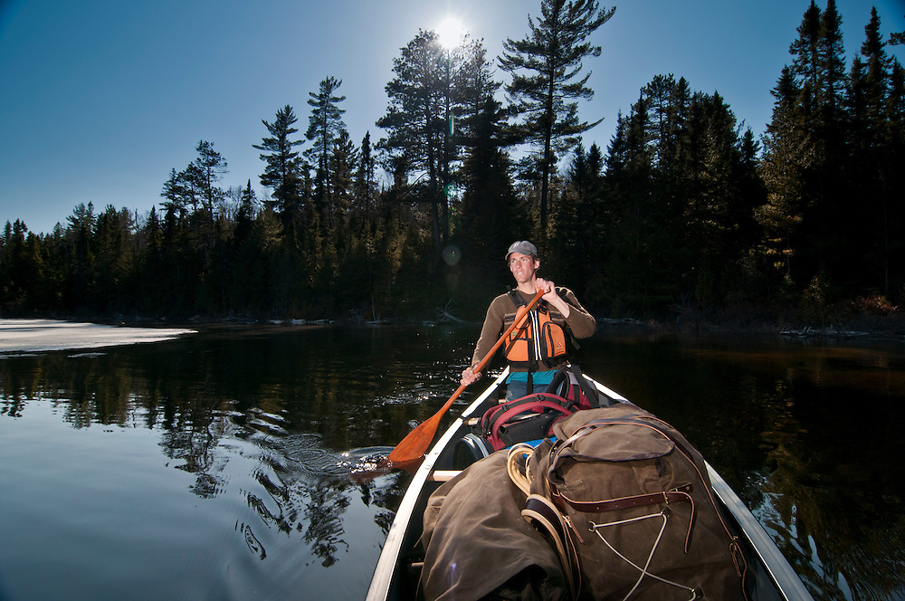 A solo canoeist on Marina Lake at Lady Evelyn-Smoothwater Provincial Park in Ontario Canada.