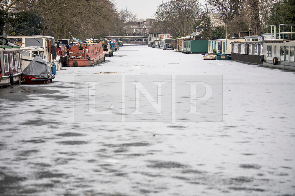 © Licensed to London News Pictures. 11/02/2021. London, UK. The Grand Union Canal frozen over at Little Venice, West London, following another night of sub zero temperatures in the capital. Photo credit: Ben Cawthra/LNP