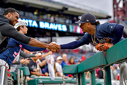 May 22, 2018 - Philadelphia, PA, U.S. - PHILADELPHIA, PA - MAY 22: Atlanta Braves second baseman Ozzie Albies (1) shakes hands with a fan before the MLB game between the Atlanta Braves and the Philadelphia Phillies on May 22, 2018 at Citizens Bank Park in Philadelphia PA. (Photo by Gavin Baker/Icon Sportswire) (Credit Image: © Gavin Baker/Icon SMI via ZUMA Press)