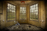 Commode chair by the window at West Park abandoned asylum http://www.vivecakohphotography.co.uk/2011/04/29/watching-and-waiting/