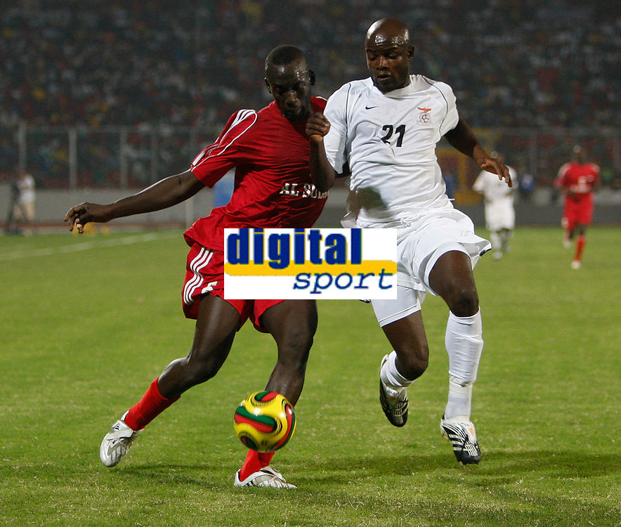 Photo: Steve Bond/Richard Lane Photography.<br />Sudan v Zambia. Africa Cup of Nations. 22/01/2008.  Ahmed Aleldin (L) tries to get around James Chamanga (R)