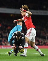 Football - 2019 / 2020 Premier League - Arsenal vs. Brighton & Hove Albion<br /> <br /> Brighton & Hove Albion's Aaron Connolly battles for possession with Arsenal's David Luiz and Bernd Leno, at The Emirates.<br /> <br /> COLORSPORT/ASHLEY WESTERN