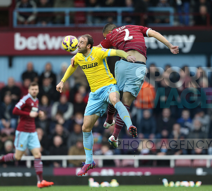 West Ham's Winston Reid tussles with Crystal Palace's Glenn Murray<br /> <br /> Barclays Premier League - West Ham United  vs Crystal Palace  - Upton Park - England - 28th February 2015 - Picture David Klein/Sportimage