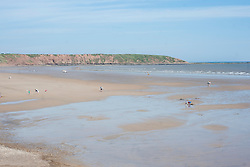 Holiday makers head out across the flat Beach during the May Bank Holiday. Filey, North Yorkshire<br />  <br /> 21 May 2013<br /> Image © Paul David Drabble<br /> www.pauldaviddrabble.co.uk