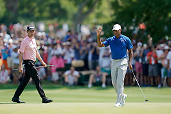 August 11, 2018 - St. Louis, Missouri, United States - Tiger Woods (R) waves to the crowd after putting the 6th green during the third round of the 100th PGA Championship at Bellerive Country Club. (Credit Image: © Debby Wong via ZUMA Wire)
