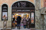 Cinema-goers buy tickets for Kino Lucerna in the marbled atrium kiosk in Lucerna Gallery, on 19th March, 2018, in Prague, the Czech Republic. Lucerna is the most elegant of Nove Mesto's many shopping arcades runs through the art-nouveau Lucerna Palace (1920), between Stepanska and Vodickova streets. The complex was designed by Vaclav Havel (grandfather of the former president), and is still partially owned by the family. It includes theatres, a cinema, shops, a rock club and several cafes and restaurants. Here St Wenceslas sits astride a horse that is decidedly dead; it's safe to assume this is a reference to Vaclav Klaus, president of the Czech Republic from 2003 to 2013.