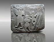 Picture & image of a Neo-Hittite orthostat showing a Conjurer & acrobats from Alacahöyük, Alaca Çorum Province, Turkey. Museum of Anatolian Civilisations, Ankara.  The conjurer on the left has long hair and is swallowing a dagger whilst the acrobats go up the stairs without holding on. All the figures are wearing horned headress and large looped earings. The acrobats are thought to be foreigners which is why they are smaller than the conjurer. Old Bronze age Chalcolithic Period.