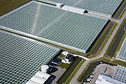 Nederland, Utrecht, Harmelen, 04-03-2008;  kassencomplex ten westen van Vleuten in de Polder Breudijk, tuinderswoning te midden van bassins voor opvang regenwater; wateropvang bassisn en tanks; agrarische industrie, bio industrie, glastuinbouw, kassenbouw, tuinbouw, energie, intensief ruimtegebruik, glas, kas, kassen, glastuinbouw, tuinbouw, CO2 uitstoot. .luchtfoto (toeslag); aerial photo (additional fee required); .foto Siebe Swart / photo Siebe Swart