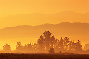sunrise over the hills in the Fraser Valley<br /> Harrison <br /> British Columbia<br /> Canada